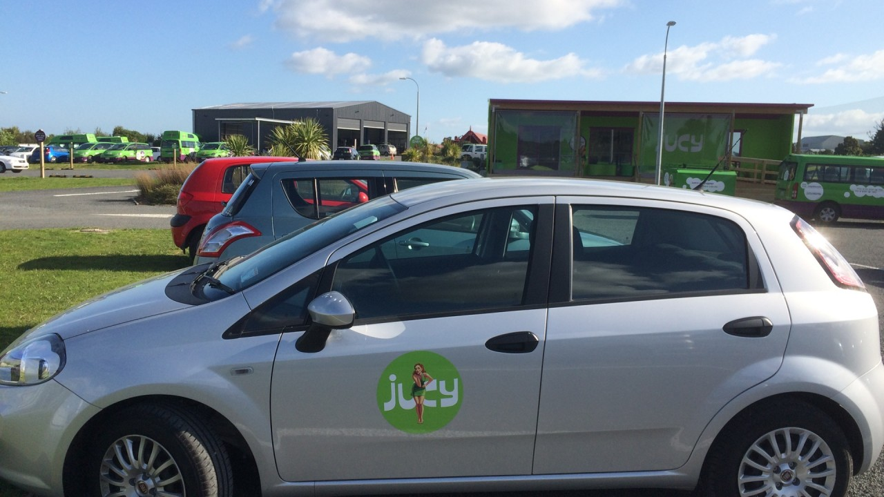 the jucy car in front of the small rent a car station